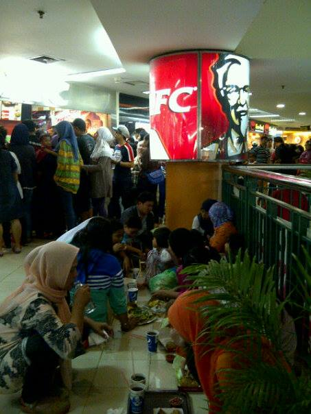 Indonesians breaking Ramadhan's fasting at a fast-food restaurant.